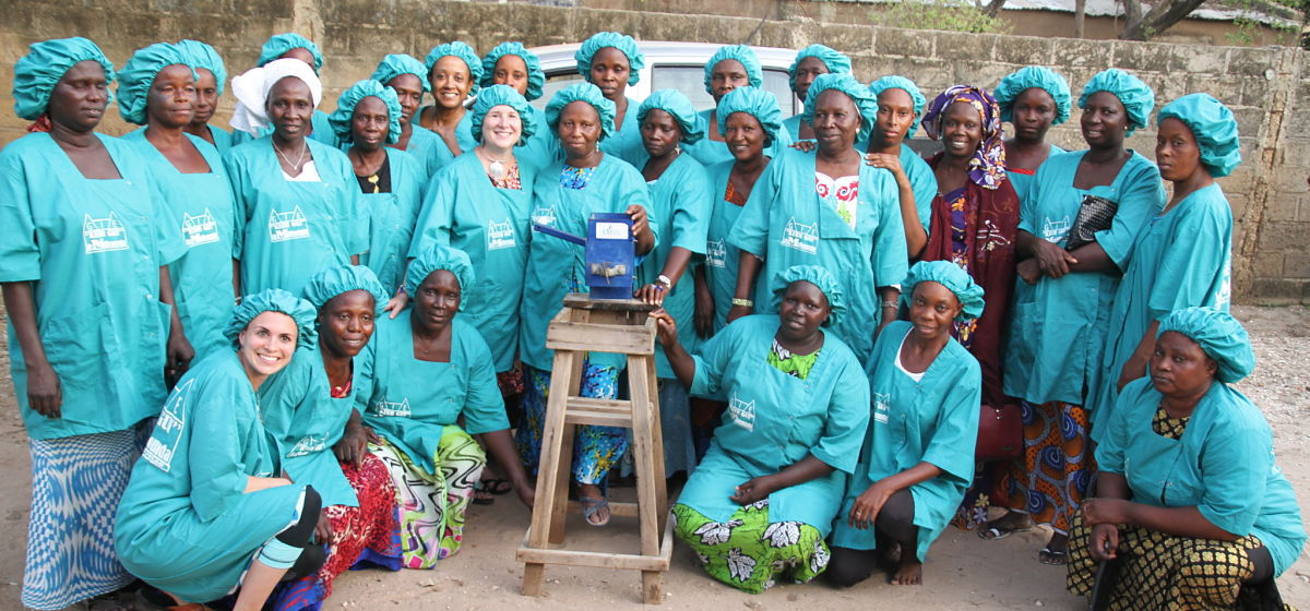 A Senegalese Women's cooperative who has been working with a client of The Improve Group, using the Millet Thresher and Grinder as a dual system to bring grain to market.