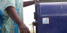 A local Senegalese farmer operates the CTI Thresher, a product design to process millet.