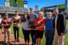 Members of PeaceMaker partner schools experiencing who demonstrated the sharpest decline in bullying rates are honored at a Twings game