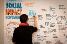 Amy Sparks creating a visual graphic to represent the discussions during our convening on Social Impact.