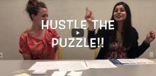 "Snapshot from a recorded video that says ""Hustle the Puzzle!!"""