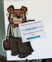 Sign at the entrance of our new office, pointing visitors to our suite on the third floor